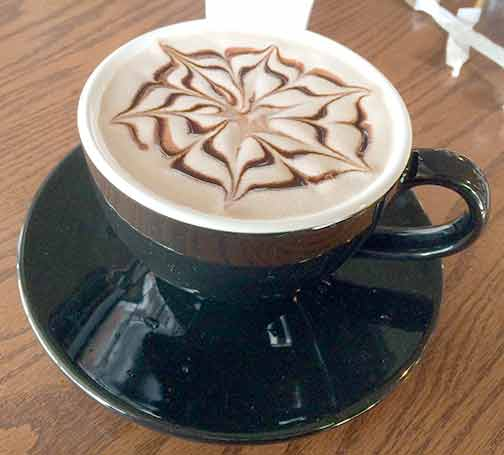 The design in the foam of my hot cocoa at the Tomato Pie Café